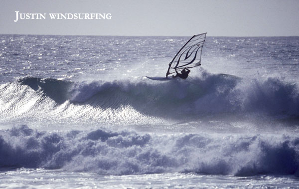 Justin Wheeler windsurfing in waves